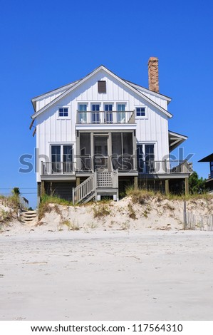 Beach rental property on pretty summer day - stock photo