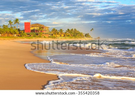 Beach resort at a tropical island at sunset - stock photo