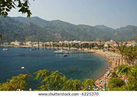 Beach resort with turquise sea shore - stock photo