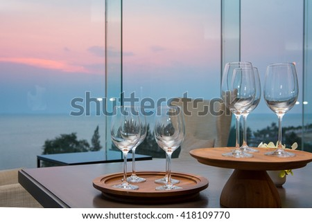 Beach restaurant with sea view, table with empty wine glasses, at hotel - stock photo