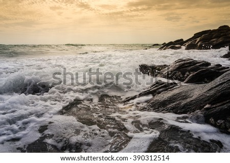 Beach rock and blue sea in Thailand - stock photo