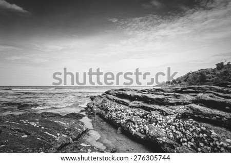 Beach rock and blue sea in Thailand vintage - stock photo