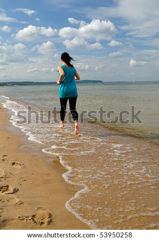 Beach running lady