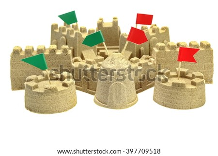 Beach Sand Castle With Different Color Red And Green Flags On Tower Tops, Indoor Or Outdoor Activity, Battle Concept, Close Up, Isolated - stock photo