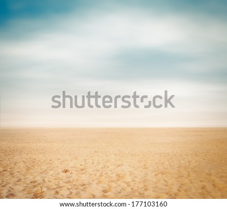 Beach sand landscape on cloudy sky for background - stock photo