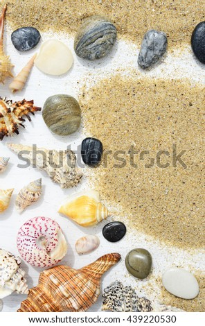Beach sand, sea shells and starfish on a white wooden background - stock photo