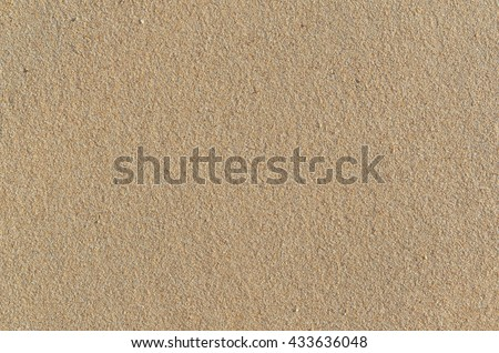 Beach sand surface texture in Algarve, Portugal. Natural textures and backgrounds
