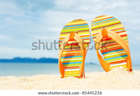 Beach sandals on the sandy coast