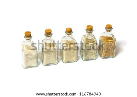 Beach sands varieties collection in five small glass bottles - stock photo