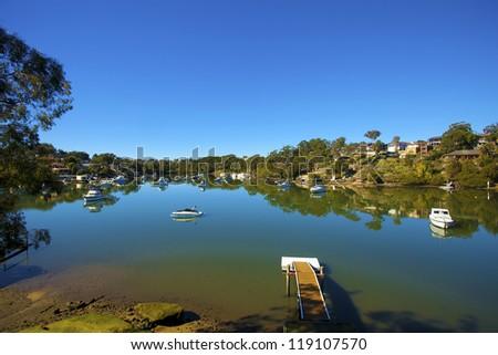 beach scene against vibrant blue sky - stock photo