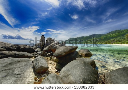 Beach Scene  over rocks Seychelles