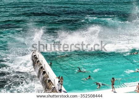 Beach Scene: Rock Swimming Pools overlooking Tasman Sea in Bondi, Sydney - Australia. - stock photo