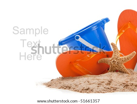 Beach scene with flipflops, sand, blue bucket and starfish on white with copy space - stock photo