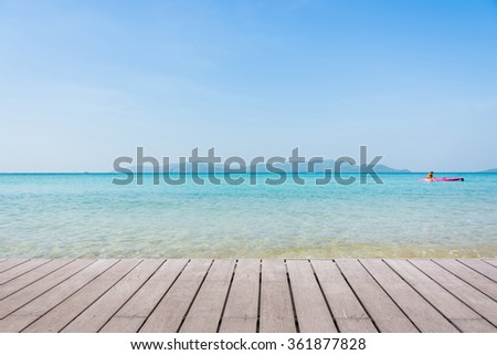 Beach Scene With Wooden Floor background can put or montage your products - stock photo