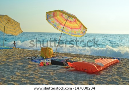 beach sea umbrellas  - stock photo