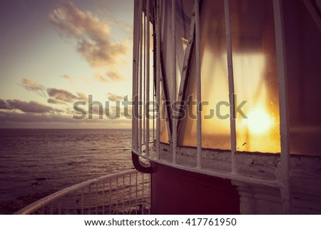 Beach shore view from the top of lighthouse, panoramic ocean coast landscape at sunset. - stock photo