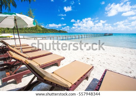 beach side bench with umbrella.