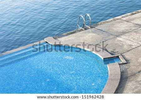 Beach side swimming pool at resort