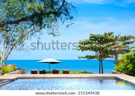 Beach side swimming pool at resort Thailand - stock photo