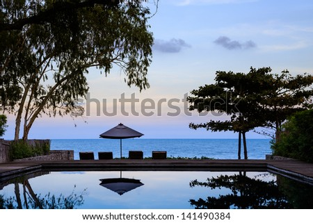 Beach side swimming pool at twilight, Thailand - stock photo
