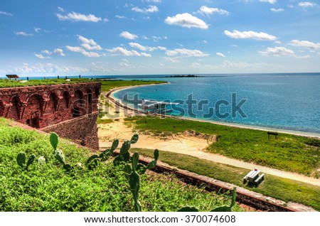 Beach, small airplane and turquoise ocean - tropical paradise island, Dry Tortugas, Florida, US - stock photo