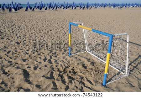 Beach soccer goal along seaside