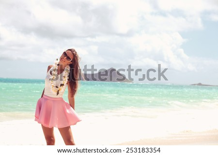 Beach summer holidays woman in happy freedom concept, out in happiness on a bright beach with sea in the background. Holiday resort vacation. Hawaii, United States Island of Oahu - stock photo