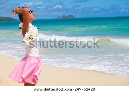 Beach summer holidays woman in happy freedom concept with arms behind head, out in happiness on a bright beach with sea in the background. Holiday resort vacation. Hawaii, United States Island of Oahu - stock photo