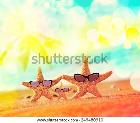 Beach. Summer. Starfish in sunglasses on the seashore. - stock photo