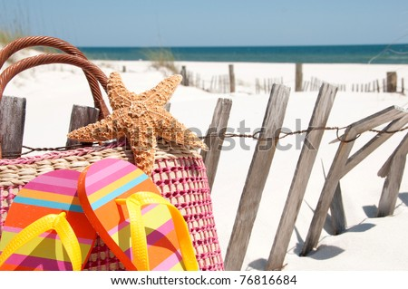 beach supplies by sand dune fence - stock photo