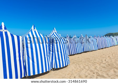 Beach tents In Zarautz, Basque Country (Spain)  - stock photo