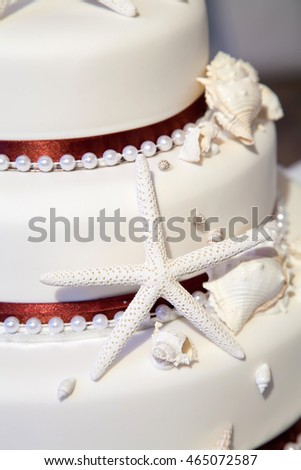 Beach theme wedding stock images royalty free images vectors beach theme wedding cake with starfish and shells junglespirit Choice Image