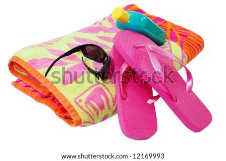 Beach towel, sunglasses, flip flops, and sunscreen isolated on white background with clipping path. - stock photo