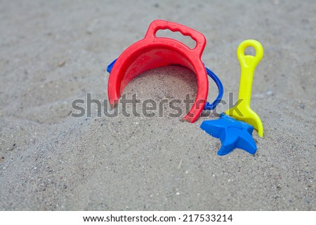 beach toys in sand - stock photo