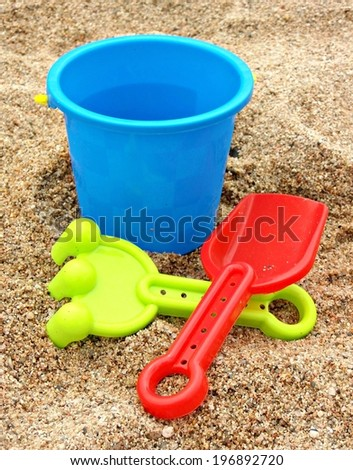 Beach toys on sand background - stock photo