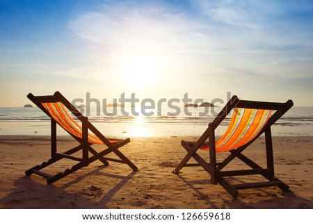 beach, two deck chairs and blue sky - stock photo