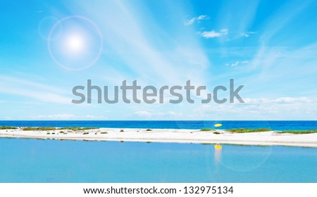 beach umbrella alone in the sand - stock photo