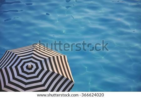 beach umbrella near the water - stock photo
