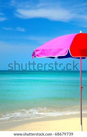 Beach umbrella on a sunny day - stock photo