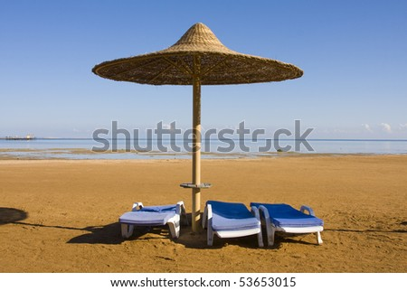 Beach umbrella on the shore of the Red Sea. Hurghada city in Egypt.