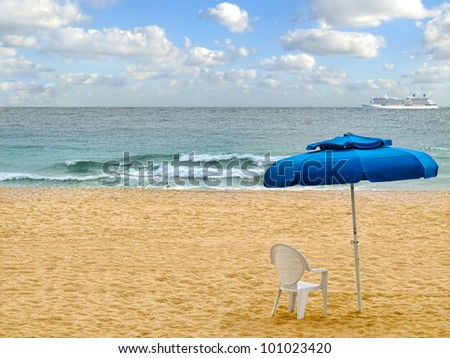 Beach.  Umbrella with chair on the beach - stock photo