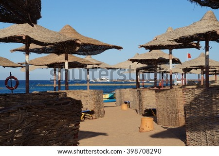 Beach umbrellas in the evening, Iberotel Makadi Oasis, Hurghada, Egypt