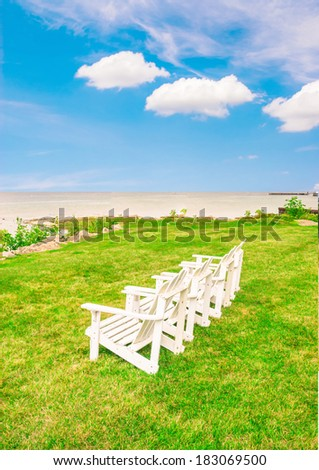 Beach vacation, Adirondack chair relaxation - stock photo