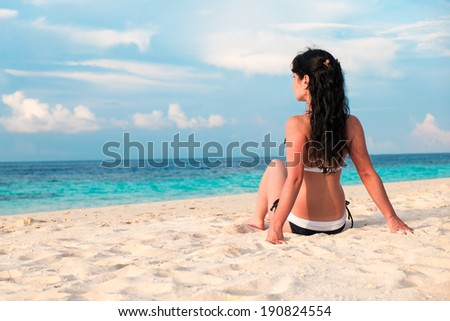 Beach vacation. Girl and tropical beach in the Maldives. - stock photo