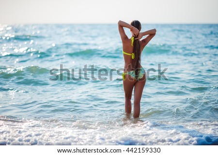 Beach vacation. Hot beautiful woman enjoying looking view of beach ocean on hot summer day. - stock photo