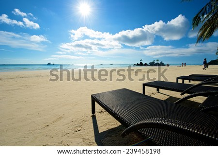 Beach view with recliner in Boracay Island in the Philippines. - stock photo