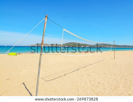 beach volley net with surfboard in the background - stock photo