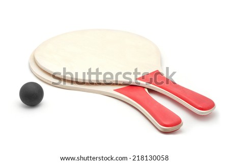 beach volley paddles and ball - stock photo