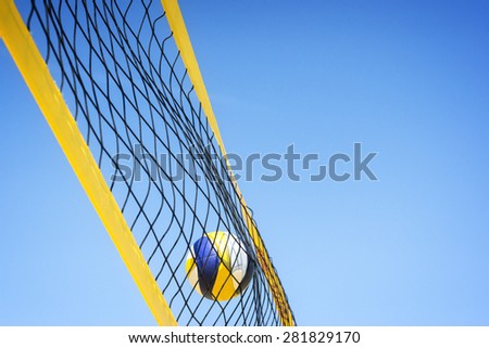 Beach volleyball caught in the net. - stock photo