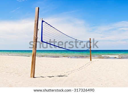 Beach Volleyball field and net in Miami Florida on a beautiful sunny summer day - stock photo